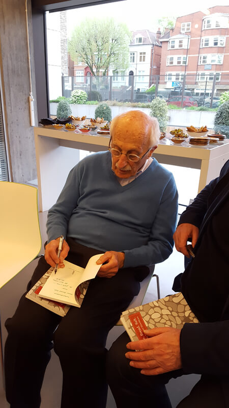 Norbert Hirschhorn signing his book
